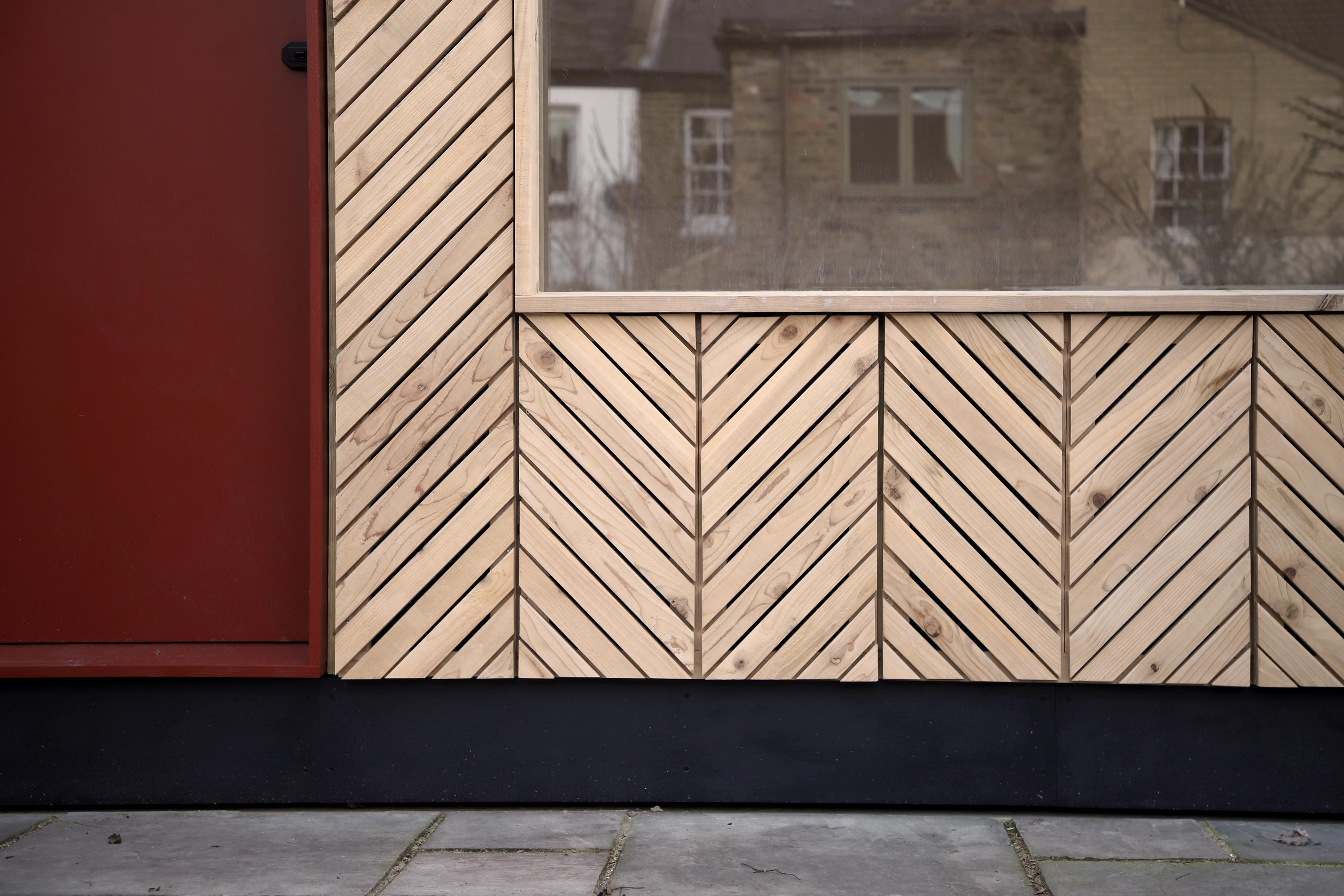 Exterior timber cladding detail shot of the self build Manbey Pod located in London, built by using the U-Build system