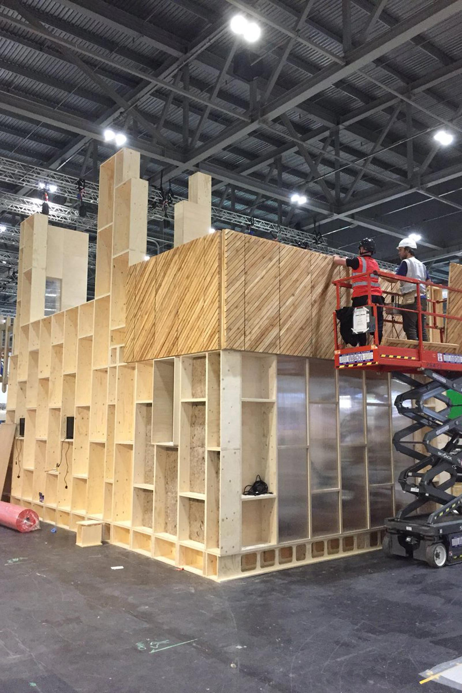 Studio Barkis setting up their U-Build stand at the Grand Designs Live Show